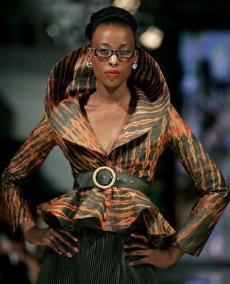 """A model displays an outfit created by Stoned Cherrie with the theme """"Fashion for food"""" to create the awareness of child hunger during Joburg Fashion Week Photo: Reuters"""