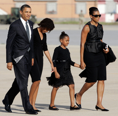 President Barack Obama, his eldest daughter Malia and youngest Sasha, and first lady Michelle arrive at Pratica di Mare's military airport, near Rome, Friday, July 10, 2009. After attending a three-day G8 (Group of Eight) Summit meeting in L'Aquila, central Italy, President Obama sat down with Pope Benedict XVI at the Vatican on Friday for a meeting in which frank but constructive talks were expected between two men who agree on helping the poor but disagree on abortion and stem cell research. (AP Photo/Riccardo De Luca)
